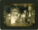 """From the Bat Nelson Collection, the Ascher Meat Market in Alta Vista was located in the Masonic Building. Seen in this 1910 photograph, left to right are Bat Nelson, Victor Steinmeyer, Mrs. Jack Bunger, Mrs. Decker, Phil Christ, Purly McClane, and William Wahl. Behind the counter from left to right are, """"unknown"""" and William Ascher."""