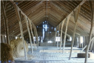 This interior view of the hay loft in the Peter Thoes barn was taken in the early 1980s, before the far end of the barn deteriorated and was removed. Photo by Greg Hoots.