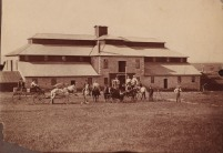 J.P. Wiser's expansive cattle ranch, located in southern Wabaunsee County was managed by Wiser's son, Harlow Wiser. In this view, from around 1900, a team of railroad surveyors are visible in the foreground. Notice that the windmill which sat atop the barn had been removed by this time. Photo Courtesy Ellen Coffman.