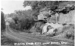This real photo postcard, circa 1910, shows K-4 Highway looking north at the Mission Creek Valley. The creek crosses K-4 about a mile north of Dover. Notice that K-4 was not paved when this photo was taken. Photo courtesy Greg Hoots.