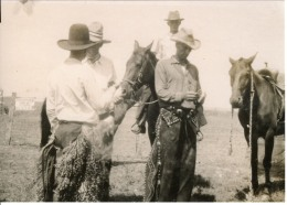 Three cowboys visit between events at the Silver Moon Ranch rodeo arena in this early 1920s view. Ranch owner, Ulysses Frank is seated on horseback in the background. Photo courtesy Trish Ringel.