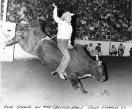 Cleo Schultz competed in bull riding and other rodeo events across the country. In this view, dated 1962, Schultz is seen riding a bull at the Tulsa Stampede. Photo courtesy Cleo Schultz.