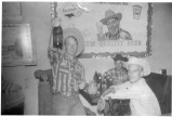 "These Flint Hills cowboys stop for a small celebration after a successful rodeo, circa 1959. Dale ""Little Red"" Wilson, left was known to be a great storyteller, and a second, unidentified cowboy, center, and Ron Pletcher appear to be enjoying the tale. Photo courtesy Shirley Pletcher."
