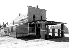 When this photo of the Keene Grocery was taken in the 1950s, the store had gas pumps very near the edge of K-4 Highway. By this time, the east addition to the store was just a one-story structure.