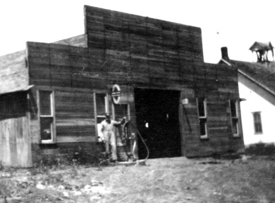 An unidentified an stands in front of the blacksmith shop at Keene, Kansas in this view, circa 1920. Notice that the Keene School is visible to the right, located quite near the blacksmith shop. Both buildings were located at the intersection of K-4 Highway and Missile Base Road.