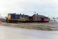 The last train which ran on the Atchison, Topeka & Santa Fe Railway tracks at Eskridge pulls out of the depot in this 1972 photograph by Eskridge businessman, Dean Dunn.