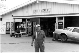Longtime Paxico, Kansas businessman, Eddie Meinhardt is seen here in front of his service station located at Newbury and Main Streets in Paxico. Photo courtesy the Eddie Meinhardt family.