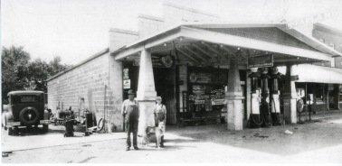 John Senne, left, his son, Paul Senne and Rex, the dog, pose for this photo at Senne's garage in McFarland, Kansas in the summer of 1930. A customer had brought a new 1930 Model AFord into the shop to put it on the lift to look underneath the car. Photo courtesy Paul Senne.