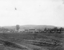 Gus Meier photographed a funeral procession entering Alma from the south. Visible in the background is the first CRIP depot which burned to the ground on August 31, 1900. Photo courtesy Emmett Burleson.