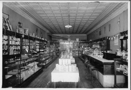 Preston Dunn, left, is seen in this interior view of his Rexall drug store in Eskridge, Kansas, circa, 1940. Photo courtesy Dean Dunn.