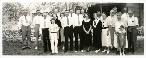 Gus Meier photographed the Palenske-Hallgren wedding party at Alma in 1935. Louis Palenske stands at the far right with Emma Palenske to his right, holding granddaughter Rita Stella Faulders' arms. Earl and Florence Hallgren stand at the center of the group.