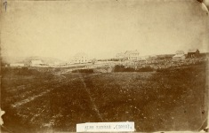 This is the earliest known photograph of Alma, Kansas, dated 1869. The two joined buildings in the center of this view are the first Wabaunsee County Courthouse on the right and the Meyer store on the left. The tall white building to the left of center is John Winkler's first hotel. A few other small buildings are visible.