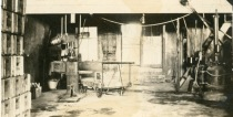 This is an interior view of the Burlington Bottling Works, Burlington, Kansas when it was being operated by Henry and Ethel Falk, formerly of Alma.
