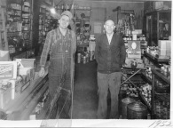 Marvin Hendricks, left, and Gus Mueller are seen inside the hardware store which Hendricks purchased from Mueller in 1952. Photo courtesy Gwen Hendricks.