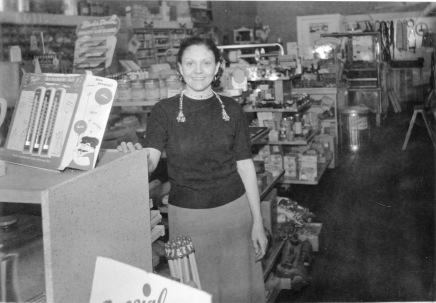 Gwen Hendricks stands by the merchandise counters in the hardware store that she and her husband, Marvin, purchased in 1952. This view was taken in the mid-1950s.