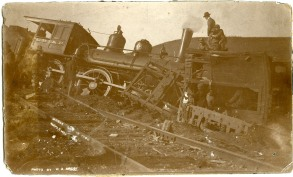 A small crowd of people inspect the wreck of a Rock Island locomotive at Maple Hill, Kansas in this photo dated November 12, 1900.