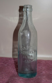 This crown-top pop bottle from the Alma Bottling Works, Alma, Kansas is on display at the Wabaunsee County Historical Society Museum in Alma, Kansas.
