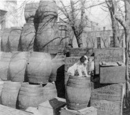 Empty beer kegs and beer cases are stacked behind the saloon located at 226 Missouri Street in this view, circa 1890. Mueller's Hardware store is visible in the background to the right. Photo courtesy Eddie Meinhardt.