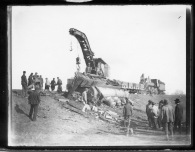 A Rock Island railroad wrecker works the scene of a derailment near Volland, Kansas, circa 1905.