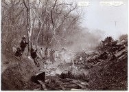 This Gus Meier photograph, circa 1898, shows the burnt wreckage of a train which derailed and crashed about a half mile west of Volland, Kansas