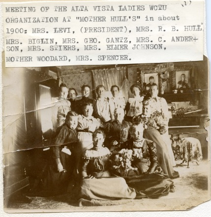 """Members of the Alta Vista Woman's Christian Temperance Union pose for a photo at a club meeting held at """"Mother Hull's"""" home in about 1900. Quite by coincidence, Mrs. Hull's husband, Dr. R. W. Hull is seen above with a group of his buddies posing in front of """"Johnnie Mac's"""" tavern in Alma."""