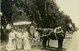 Three Alma women, Marion Ross Palenske, Mrs. W. G. Weaver, and Mrs. Jerry Fields, charter members of the Royal Neighbors of American organization, pose with their driver, Leslie Gardenhire and a parade carriage in this view dated August 11, 1928.