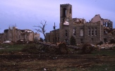 Charles Herman traveled to Topeka to photograph tornado damage from the famed 1966 storm which tore through the city. In this view one sees extensive damage to buildings on the campus of Washburn University.