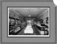 Preston Dunn, seen behind the counter at the left in this 1930s view, operated the Rexall Drug Store in Eskridge for over 50 years.