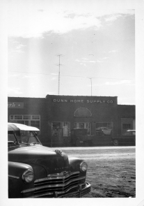 Dunn Home Supply opened in Eskridge on September 9, 1949, and this photo was taken shortly after the store's opening. Rissler's Plymouth dealership is visible to the left of Dunn's store in this view.