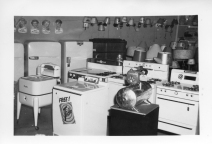 "When this photo was taken in the early 1950s, Dunn Home Supply offered a full line of appliances, including both ""ringer"" washers and the new fully automatic variety."