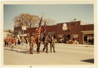 The Dunn's took advantage of the crowd in town to have a sidewalk sale on the day of a fall parade in Eskridge in this 1960s view.