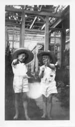 Bob Warren, left, and Dean Dunn play with their toy guns at Preston Dunn's home in Eskridge, Kansas in this view from the early 1930s.