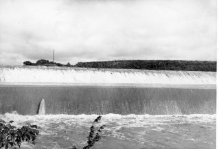 Dean Dunn photographed the flood water from Lake Wabaunsee pouring over the old spillway.