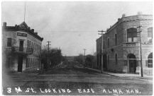 This real photo postcard from about 1908 looks to the east with the Alma Hotel located on the left and the Bank of Alma on the right.
