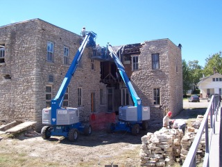 Stonemasons removed, marked and stacked, and then re-laid the original limestone of the Alma Hotel in this view dated 2010.