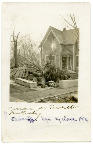This real photo postcard from 1911 shows damage to Dr. Trivett's home at Eskridge, Kansas.