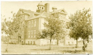 This real photo postcard shows Eskridge High School as it looked in about 1913. This view looks to the northwest.