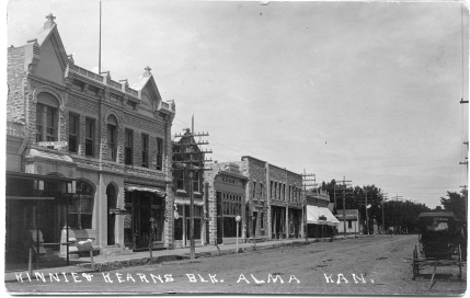 The Kinnie & Kerans building, located at 311-313 Missouri Street in Alma, was the home of the Alma National Bank (in the south side of the building) and Cassiday's Grocery (in the north side of the building) when this real photo postcard view was taken in about 1908.