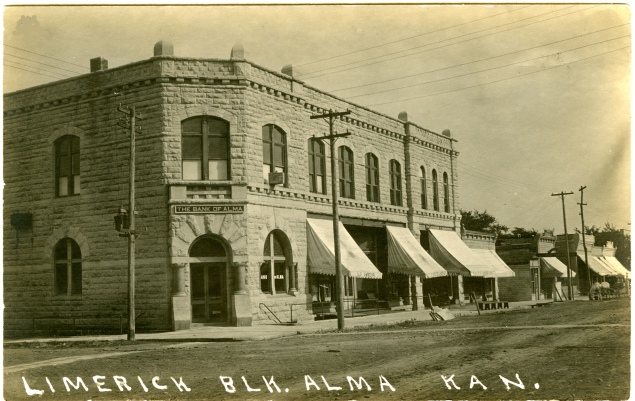 In 1932 the Alma National Bank, the Farmers National Bank, and The Bank of Alma consolidated into the 1st National Bank and moved into the Limerick Building, seen here in an early 1910s photo postcard.