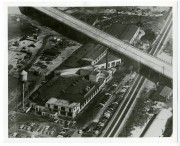 This aerial view of The Industrial Rubber Goods Co.'s Edgewater plant dates from about 1950, showing almost 100 employees' cars parked at the factory. Photo Courtesy of the Minnetrista Heritage Collection, Muncie, Indiana.