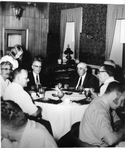 Martin Zwanziger, left center, and Fred Palenske, right center, visit with Alma Rotarians at a meeting on May 29, 1969 held at the direction of Dr. E. B. McKnight, far right in glasses, honoring Palenske for his gift of the museum to the citizens of Wabaunsee County.