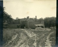 The flour mill on Mill Creek at Alma is seen here in about 1910 after the steam power plant had been added to the facility. Photo Courtesy the Palenske family.