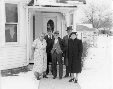 "The Palenske family stand in front of Louis and Emma Palenske's ""retirement house"", located at 604 Kansas Avenue in Alma, Kansas, in this view, circa 1940. From left, Emma Palenske, Fred Palenske, Louis Palenske, Martin Zwanziger, and Minnie Zwanziger."