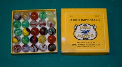 The Akro Agate Co. manufactured these marbles during the 1930s. This box of marbles was given to Brent Crow by his grandfather, Russell Woofter. Notice that the logo of the company was a crow in flight, holding marbles in its feet and beak. Courtesy Brent Crow.