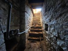 The stairway which leads to the hidden cave under the Wabaunsee County Historical Society annex opens into the museum building's floor.